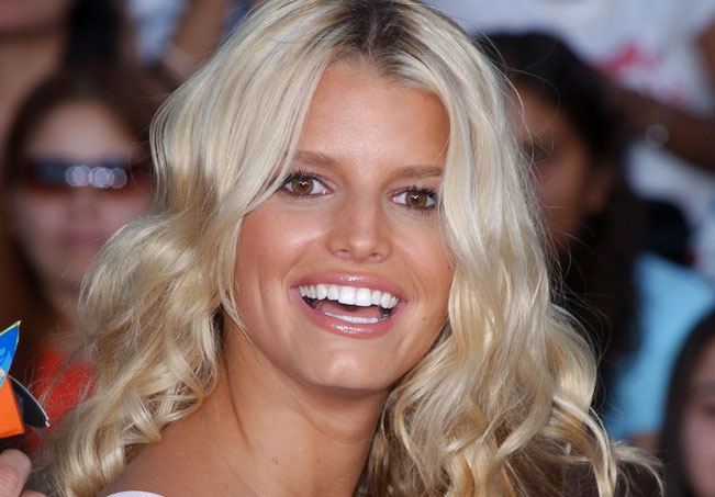 Jessica Simpson designed her own holiday card for charity and is receiving some pretty high bids for it