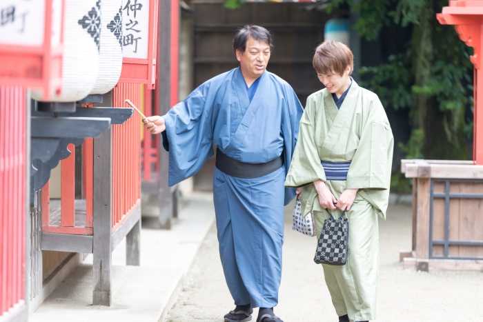 Two Japanese men in Yukata are walking on a alley with looking for ...
