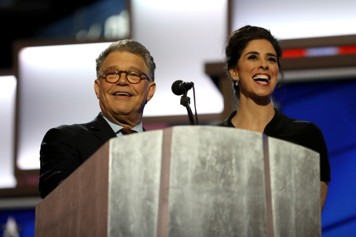 Sarah Silverman speaks as Sen. Al Franken (D-MN) looks on during the first day of the Democratic National Convention