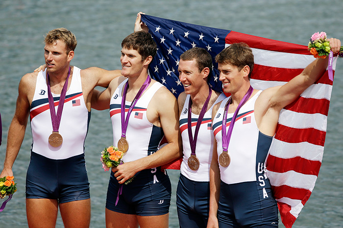 U.S. Olympic rowers, from right, Scott Gault, Charles Cole, Henrik Rummel and Glenn Ochal celebrate after winning the bronze medal in 2012
