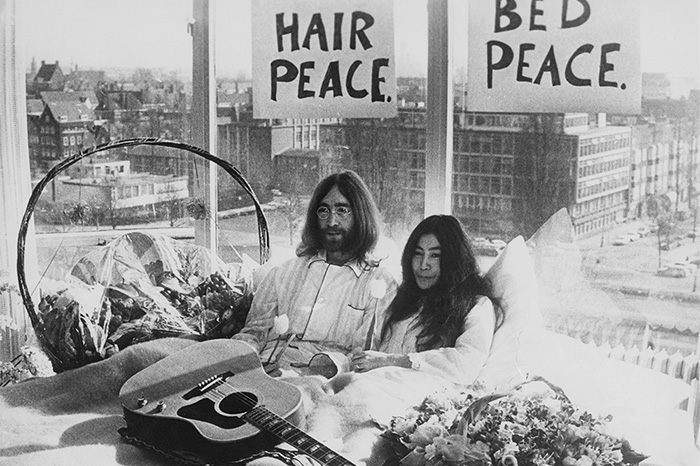 "John Lennon and Yoko Ono stage a ""bed-for-peace"" protest from their Amsterdam hotel in 1969."