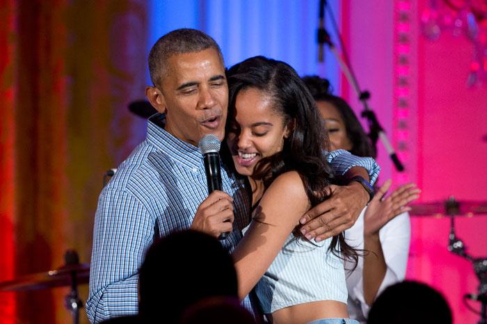 Malia Obama hugging her father