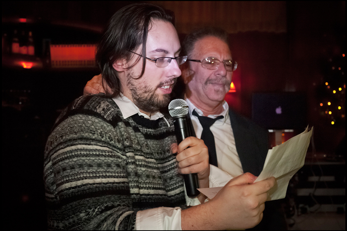 """JD Harmeyer reads Ronnie Mund's poem """"Winter"""" at the 2011 staff holiday party"""