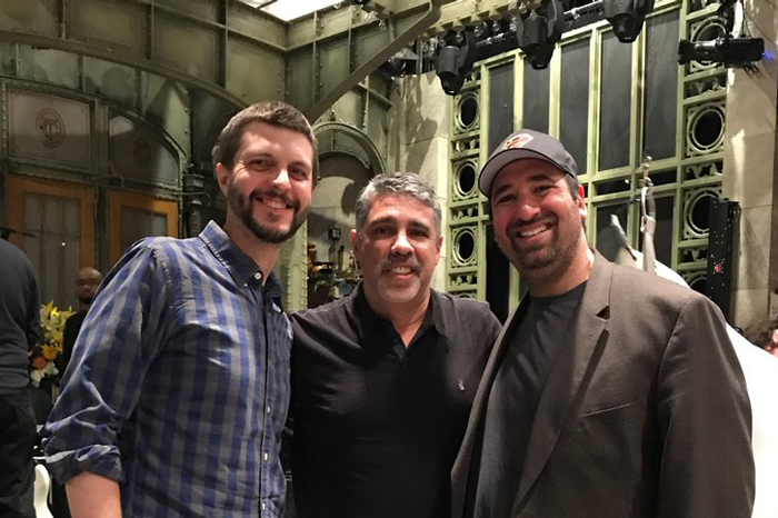 """Will Murray, Gary Dell'Abate, and Jason Kaplan in front of the """"Saturday Night Live"""" stage"""