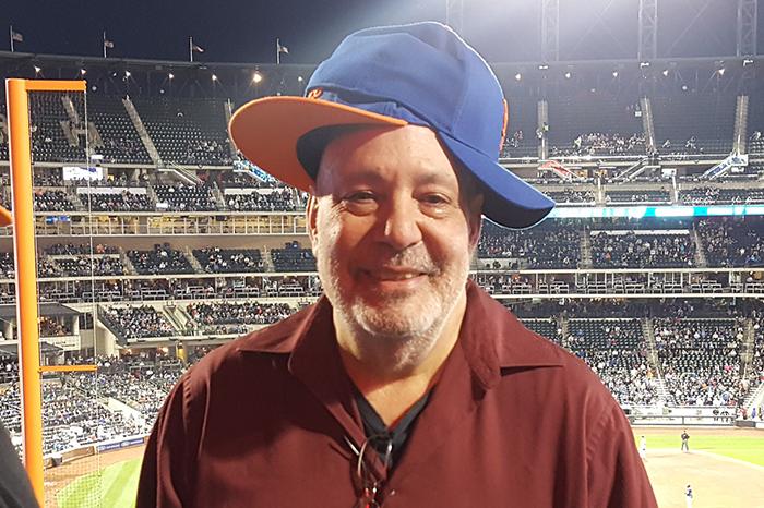 Scott Salem wearing two Mets hats