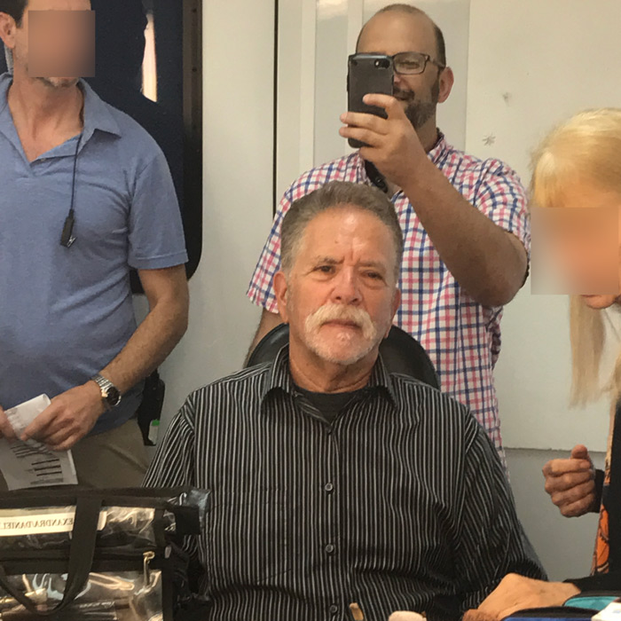Ronnie Mund sits in the makeup chair