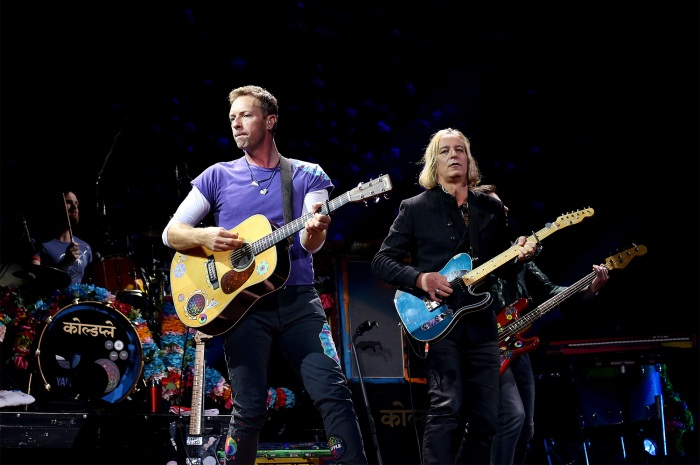 Peter Buck (right) joins Coldplay's Chris Martin (left) on stage to perform 'Free Fallin'' in a tribute to Tom Petty at Moda Center on Monday in Portland, Ore.