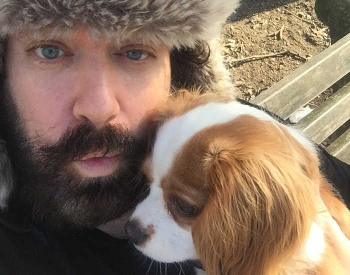 Benjy Bronk outside with his dog