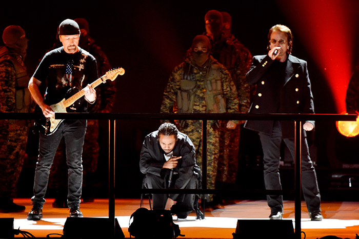 Kendrick Lamar with U2's Bono and the Edge at the 60th Annual Grammy Awards