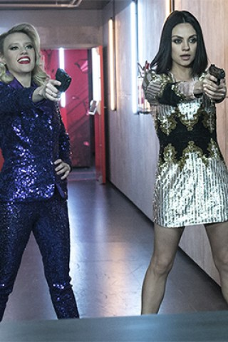 Mila Kunis & Kate McKinnon Go Guns-Out in Trailer