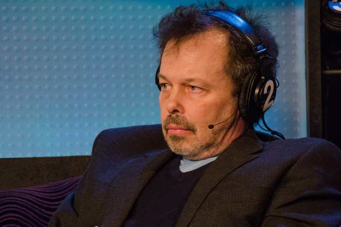 Curtis Armstrong listens as Howard plays short clips of Harry Nilsson's music