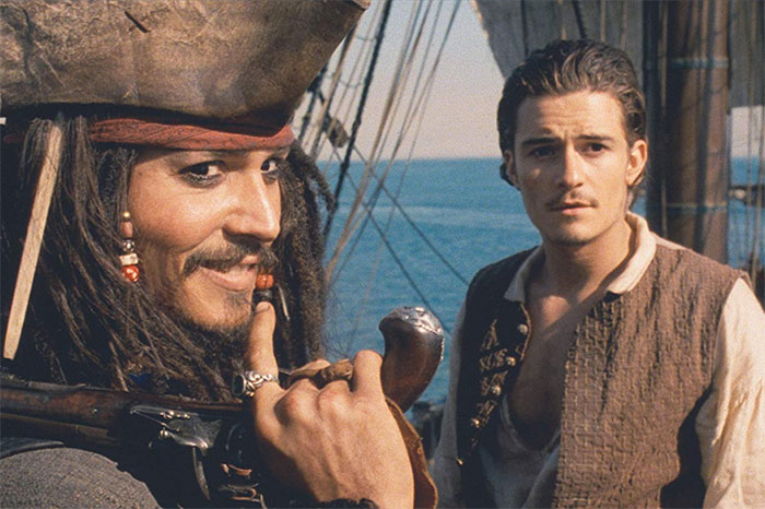 """Johnny Depp and Orlando Bloom in """"Pirates of the Caribbean: The Curse of the Black Pearl"""" (2003)"""