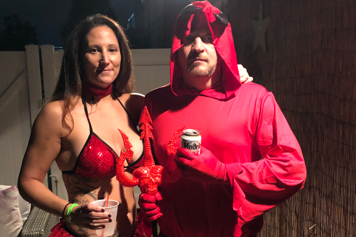 Katelyn and Brent Hatley dressed as devils for their Halloween swingers party