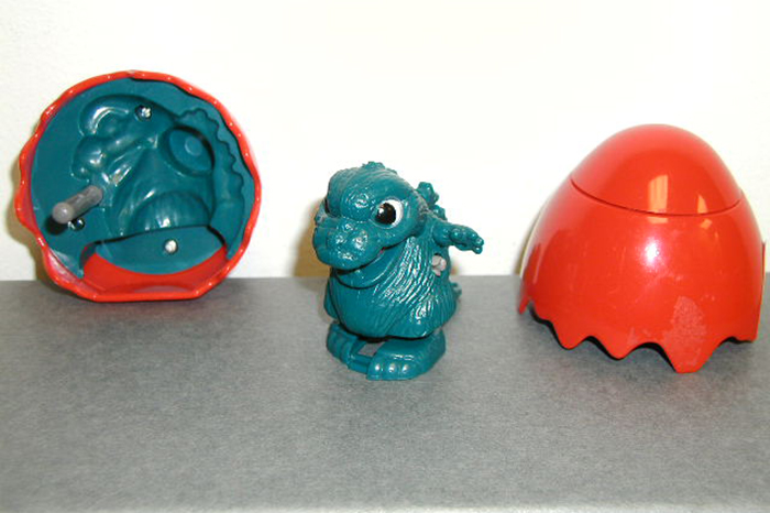 "A red egg with a wind-up Godzilla which Howard referred to as ""cute,"" but decided not to keep"