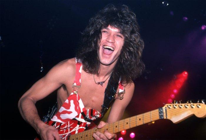 """Eddie Van Halen plays his custom Frankenstrat guitar at Cobo Arena during Van Halen's """"Hide Your Sheep Tour"""" on Aug. 13, 1982, in Detroit."""