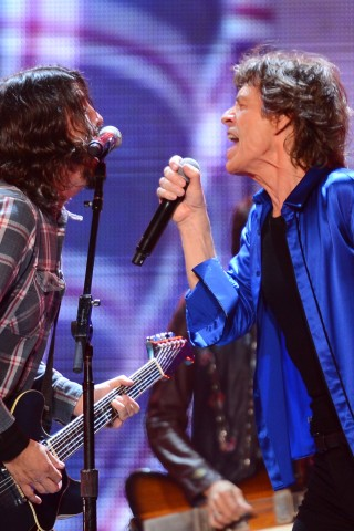 Read about Mick Jagger & Dave Grohl Team Up on 'Eazy Sleazy'