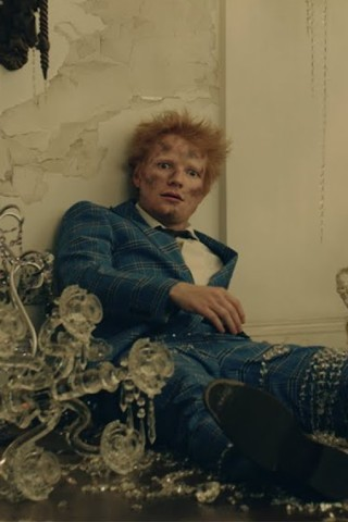 Read about Ed Sheeran Dons Elton John's Sequins in 'Shivers'